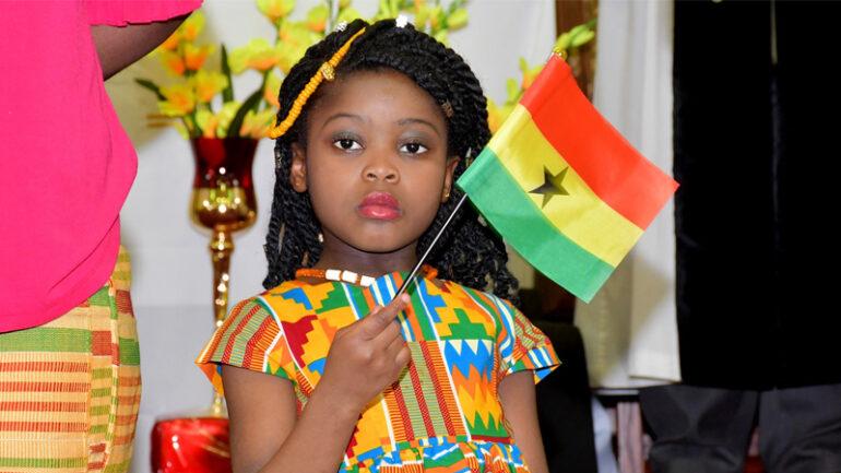 Holding_Ghana_Flag